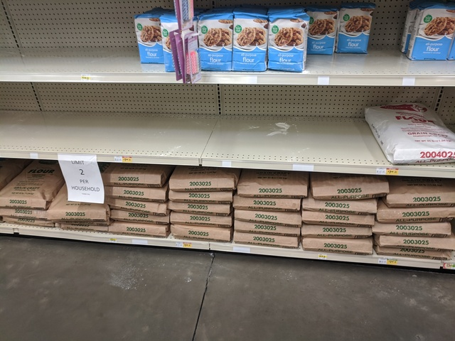 The shelves at Broulim's - a few bags of all purpose flour remain, and a ton of large 25 lb bags remain on the bottom shelf.