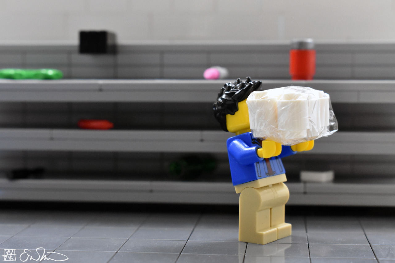 A lego person taking the last package of toilet paper from a store shelf.  Source: https://legogradstudent.tumblr.com/post/613037524918648832/grabbing-a-pack-of-toilet-paper-the-grad-student